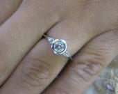 14K White gold round diamond engagement ring.