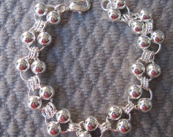 Twelve Pair Silver Bubbles with Round Connectors Bracelet