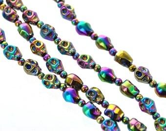 1 Strand Small Titanium Coated Rainbow HEMATITE Gemstone SKULL Beads . genuine carved stone . 10x8mm, mardi gras, ghe0063