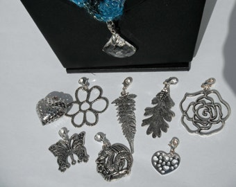 Various Silver Metal Pendants to choose from with a Silver Lobster Clasp