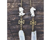 handcrafted winter shoulder dusters. howlite stones, bronze snowflake charm, clear quartz crystal point dangle long earrings.