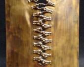 ZIP,  bronze sculpture.