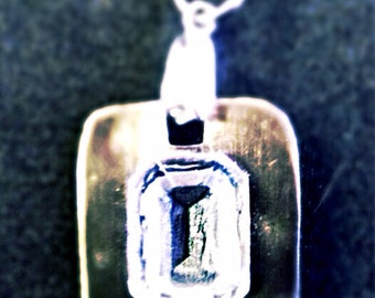 Silver brushed metal pendant with chain