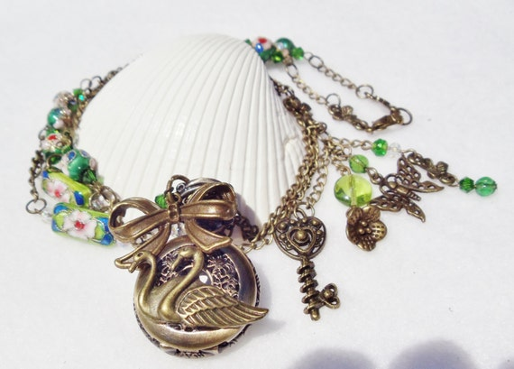 Swan pocket watch pendant with green cloisonne' beads and bronze accents