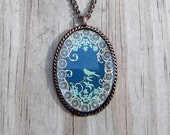 Clockpunk Steampunk Necklace, Antiqued Brass Oval, Blue Background with Bird, Flowers & Gears on Curb Link Chain