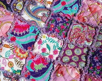 Bright, old world looking, purple rag quilt