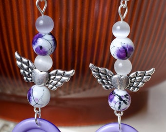 Winged button earrings