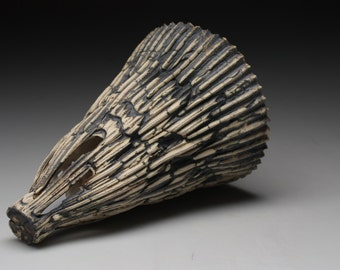Abstract ceramic sculpture with unique shape and texture