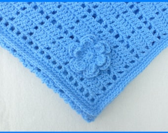 Crochet baby blanket  in dark blue.