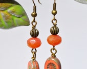 Coral carved Czech glass beads and brass dangle earrings