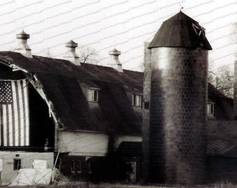 Old Black and White Barn with American Flag