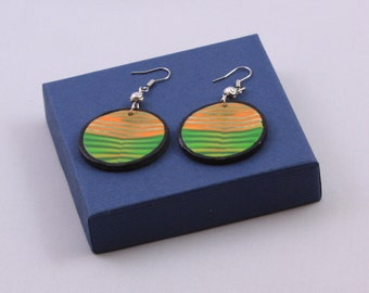 Round polymer clay earrings in green and orange stripes