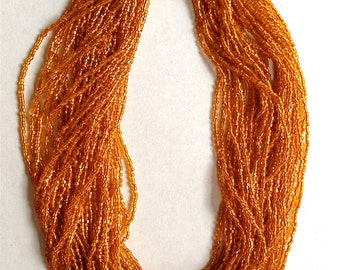 Sale: Vintage Gold Colored Seed Beed Torsade Necklace with Fancy Clasp