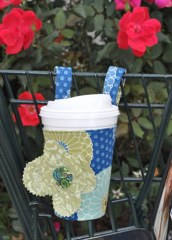 Coffee cup holder that straps on grocery or shopping cart.