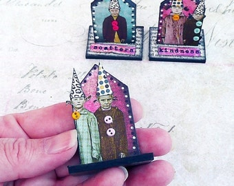 ooak mini fairy houses with children wearing pointy hats, stripey legs and big buttons