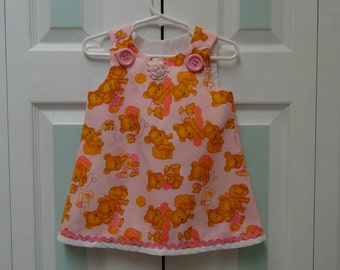 TODDLER'S CHILDS DRESS:  size 9 to 12 months, pink teddy bear print, fully lined in white pink lg. buttons