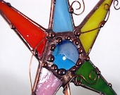 Stained glass Garden Stakes in vibrant colors with copper accents
