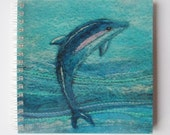 Notebook with Printed Cover Featuring a Felt Dolphin Picture