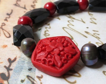 Bracelet black agate, red coral and cinnabar stones