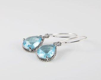 Pastel Blue Glass Earrings With A Shiny Silver Tone Frame