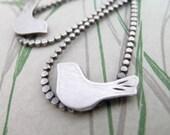 modern bird earrings handcrafted in sterling silver