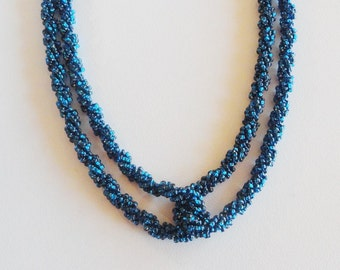 42 inch long silver lined montana blue rope spiral necklace
