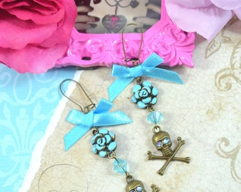 MUERTOS - Blue Roses, Bows, and Skulls - Dangly Charm Earrings in Antique Bronze