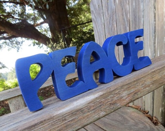 wood peace sign shelf sitter or wall hanging choice of colors