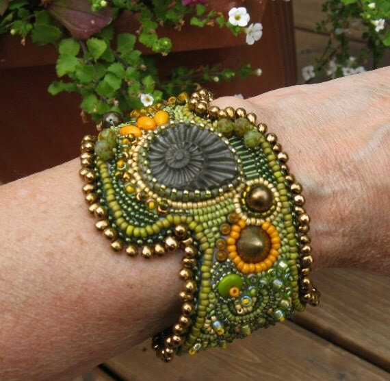 Items similar to bead embroidered ammonite cuff bracelet