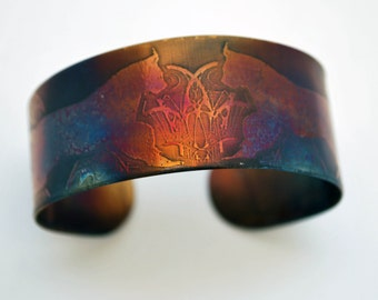 Coloured steel lynx cuff, Multi coloured stainless steel cat bangle, medium rainbow surgical steel cuff