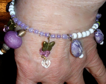Playful Youthful Charm Bracelet of Purple Lavender White Beads Goldish Butterflies and Glass Hearts