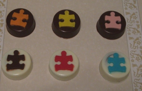 One dozen puzzle piece chocolate covered sandwich cookie party favors
