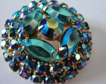 Vintage aurora borealis  brooch and pendant.