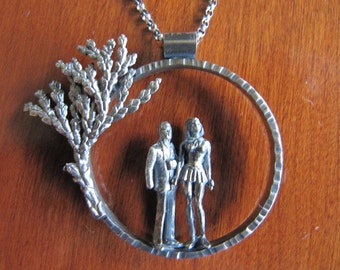 Beautiful Tiny People Necklace in Sterling Silver