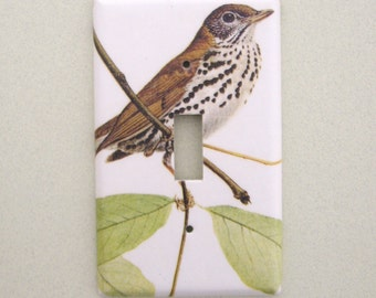 Single brown bird on a branch light switch cover switchplate