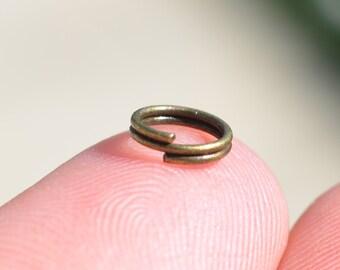 100  Bronze Tone 7mm Split Jump Rings F112