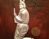 Man praying devotional milagro for  prayers answered. Silver Ex Voto