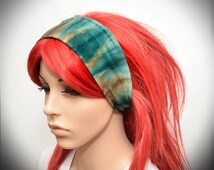 Stretchy headband with teal tie dye pattern
