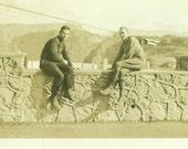 Idle Time Men Sitting on Stone Wall Bridge View 1920s 1930s Vintage Black White Photo Photograph