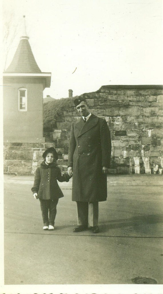 father and daughter holding hands stone wall 1940s soldier man. Black Bedroom Furniture Sets. Home Design Ideas