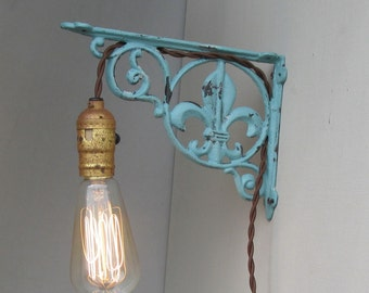 lighting ,wall light, fleur de lis , robin's egg blue