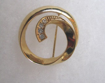 Elegant gold tone vintage circle pin brooch with rhinestone accents