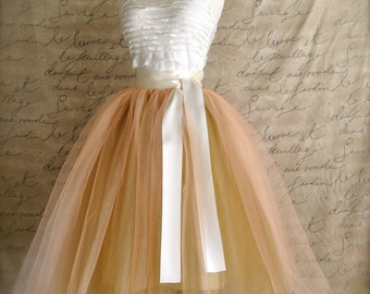 Women's tulle skirt in warm peach over antique gold lined in champagne duchess satin with matching waist.