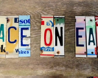 PEACE on EARTH OoAk pace shalom recycled license plate art sign mounted on weather barn wood tomboyART tomboy This Land is your Land