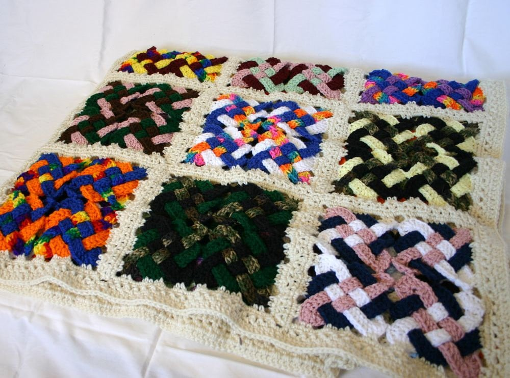 Crocheted Celtic knot afghan off white border granny square