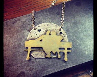 Park bench lovers necklace
