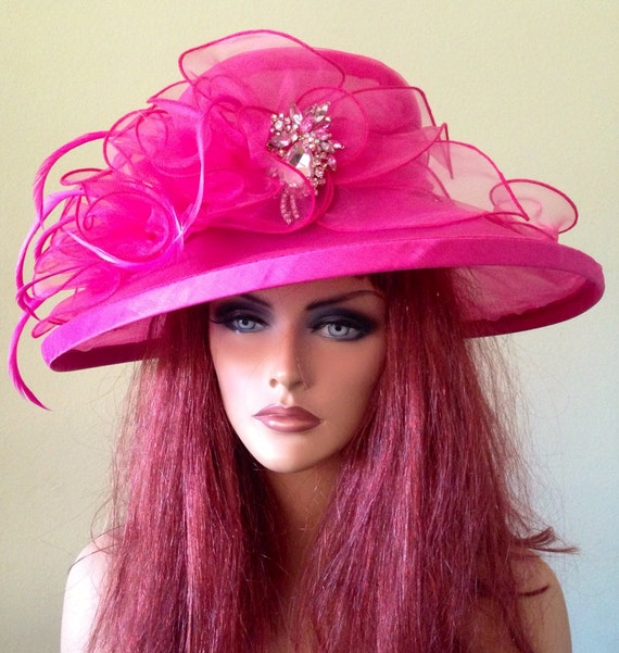 Stunning Kentucky Derby Style Church Hat. Champagne Italy Features: White with Silky Ribbon on Band and Brim Kentucky Derby Style Church Hat Ships in a Champagne Italy Pink and Black Hat Box. Orders ship same or next 1 month ago on.
