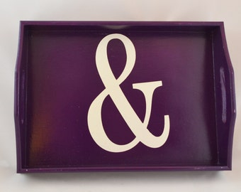 White Ampersand on a purple wooden serving tray with handles, coffee tray