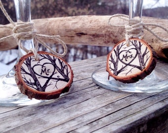 Mr. And Mrs. wine glass charms on natural cedar, juniper, birch or maple wood