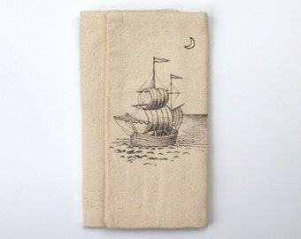 tri-fold wallet with hand drawn ship on the sea with quarter moon item number 308